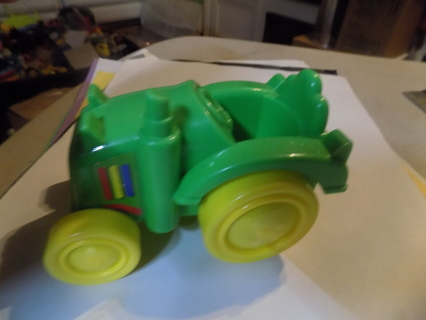 Plastic green and yellow toddler size tractor