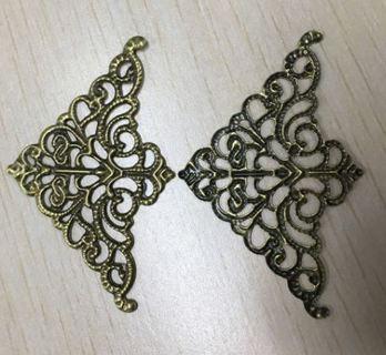 Four metal filigree wraps