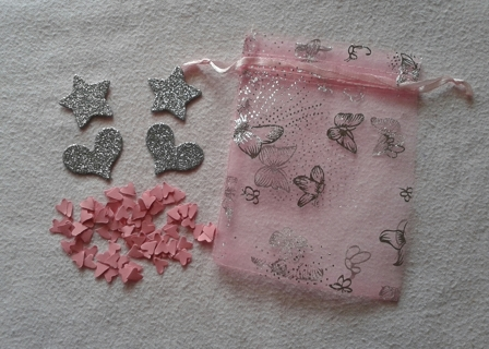 cardboard glitter cut outs and heart punches and organza bag