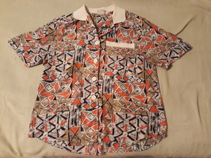 """Ladies short sleeve blouse by """"Pykettes""""."""