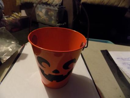 Metal orange Jack-A Lantern mini bucket 4 1/2 tall and wide