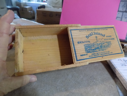 Wooden box with slide off lid could be used as trinketbox