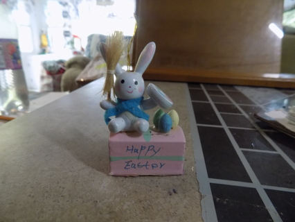 Wood white bunny on a pink block says Happy Easter