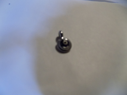 royal blue round charm with white bead circle in middle mounted on silvertone setting
