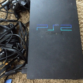 PS2 with issues comes w/ 2 remotes and all cables to play