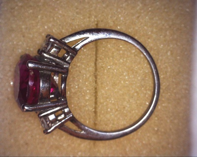 sci .925 red garnet and (diamond ?) ring