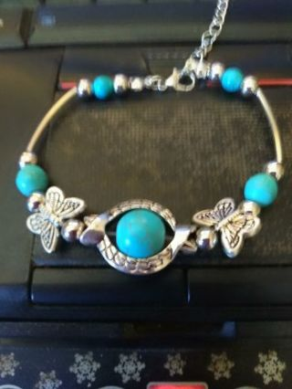 Gorgeous Bohemian style bracelet with turquoise beads and 2 butterflies....