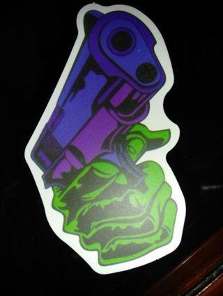 Gun in hand sticker