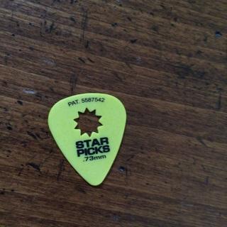 Yellow star pick guitar pick