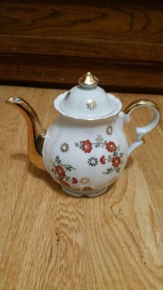 Teapot w/ gold colored spout