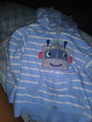 A light blue and white jacket for baby boy