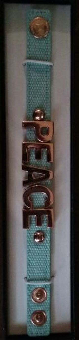 """BCBGeneration Seashell Blue bracelet with """" PEACE"""" spelled in gold charm lettering"""