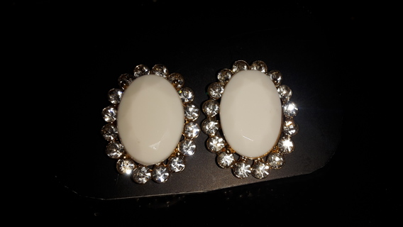 pretty white sets with rhinestones around them set in gold colored setting