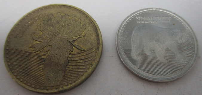Two Collectible Colombian Pesos Coins