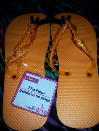 Large Orange ladies flip flops.