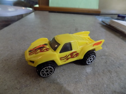 Hot wheels Yellow plastic car with fins