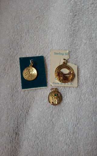 3 gold charms